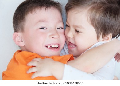 happy kids, laughing children hugging each other, closeup portrait of boy and little girl, happiness in childhood of siblings