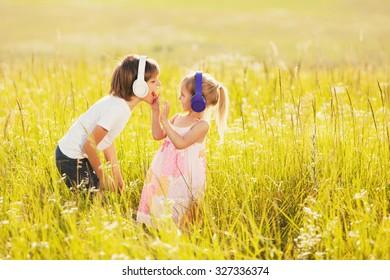 Happy kids listen to music on nature