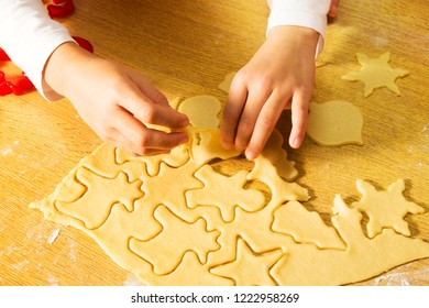 happy kids making cookies in christmas bakery  in home  kitchen