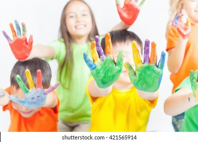 Happy kids with painted hands on a white background. International Children's Day. Painting, occupation