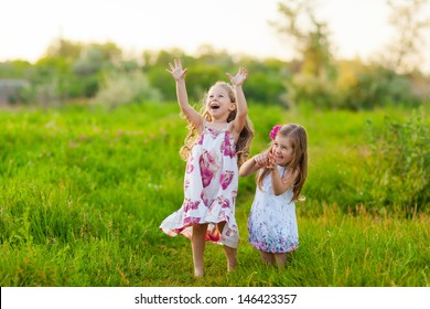 happy kids playing on the lawn