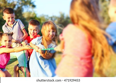 Happy kids playing in park