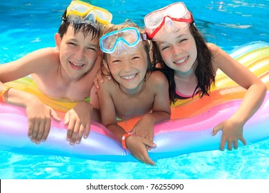 Happy kids in the pool