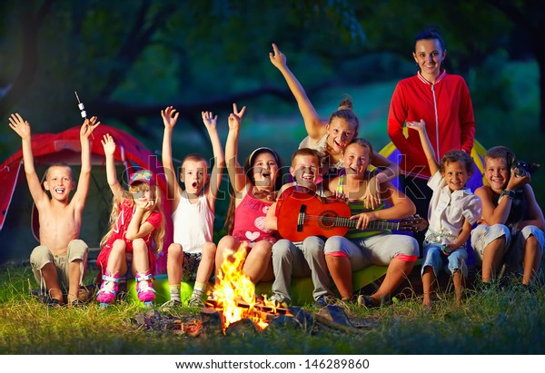 Happy Kids Singing Songs Around Camp Stock Photo (Edit Now