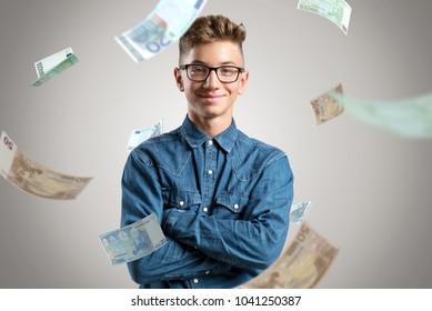 Happy kids stands in rain of money