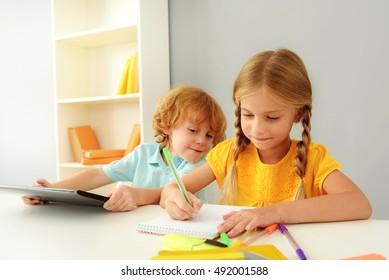 happy kids studying in kindergarten