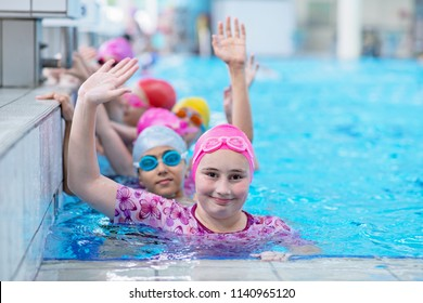 happy kids at the swimming pool. young and successful swimmers pose.
