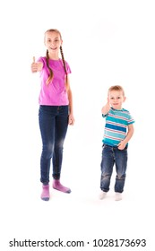 Happy kids with thumbs up or OK sign isolated on white