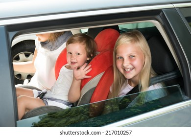 Happy Kids Traveling By Car. Outdoors Shot