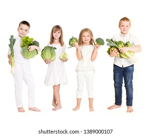 Happy kids with vegetables broccoli, onions, leek, salad on a white background