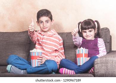 Happy kids watching their favorite TV show