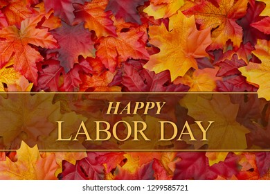 Happy Labor Day greeting with red and orange fall leaves