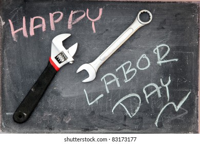 Happy Labor Day on blackboard with wrench