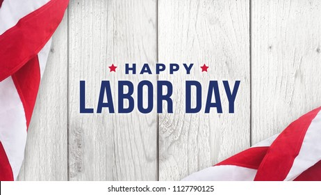 Happy Labor Day Text Over White Wood Wall Texture Background and American Flags