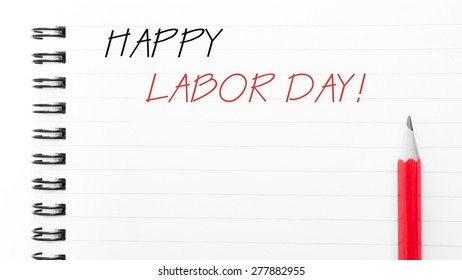 Happy Labor Day Text written on notebook page, red pencil on the right. Motivational Concept image