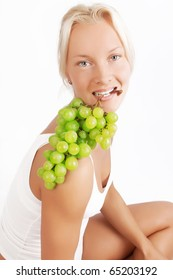 Happy lady with green grape