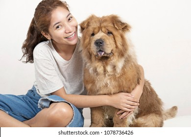 Happy lady hugging his adorable pet dog.