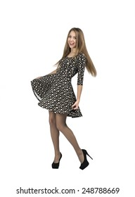 Happy lady makes romantic moves. Full body portrait of young lady in casual dress, expressing joy and happiness, on white background