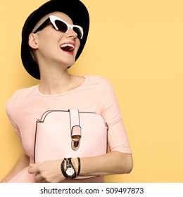 Happy Lady stylish retro hat and sunglasses. Bag. Love Vintage