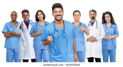 Happy latin american male doctor with motivated medical team isolated on white background for cut out
