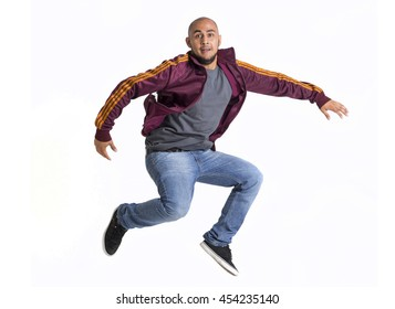 Happy latin brown bald man jumping on white background