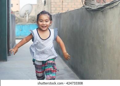 Happy latin kid running
