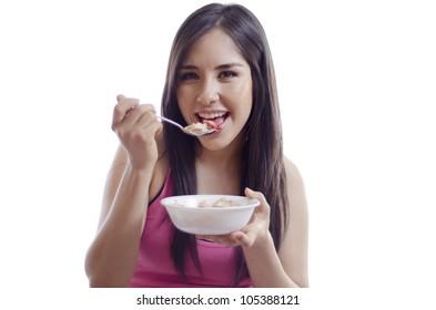 Happy latin woman having a healthy breakfast