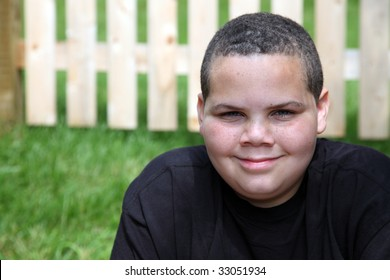 Happy latino boy portrait outside