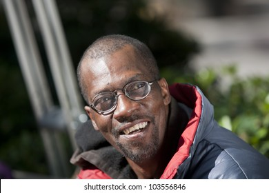 Happy and laughing african american man with glasses