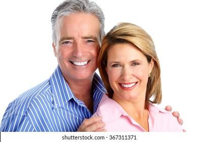 Happy laughing elderly couple.