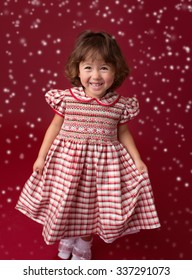 Happy, laughing girl in a Christmas dress, holiday outfit, fashion and xmas concept
