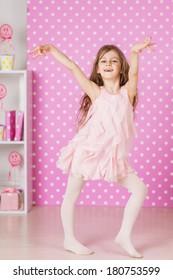 happy laughing little long hair girl dancing