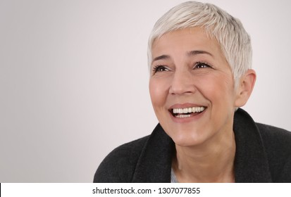 Happy laughing Mature Woman portrait. Happy people concept