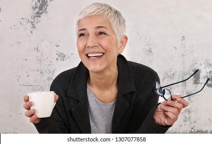Happy laughing Mature Woman portrait. Positivity concept
