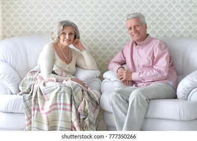 happy laughing senior couple at home