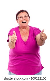 Happy laughing senior woman gesturing thumbs up, isolated on white background.