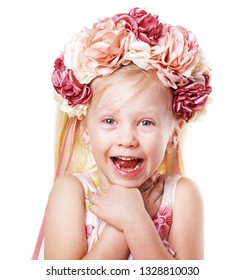 happy laughing suprised little blond girl in flower crown