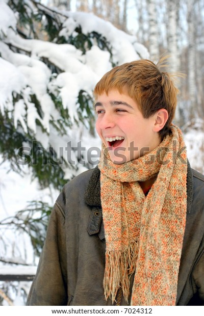 happy laughing teenager in winter forest