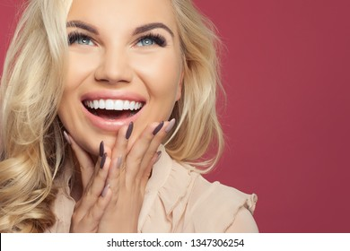 Happy laughing woman, young face closeup. Excited girl on colorful background with copy space