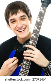 happy laughing young man with a guitar against white background