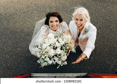 happy lesbian couple in love the weddding day facing camera