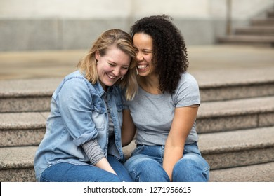 Happy lesbian couple sitting togther