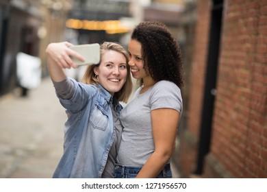 Happy lesbian couple taking a selfie