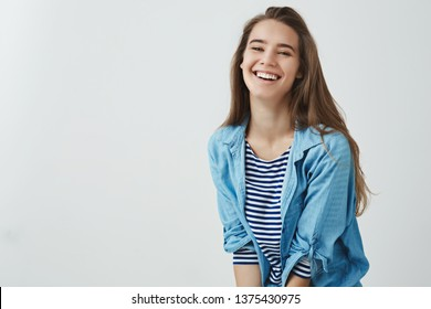 Happy lifestyle, wellbeing concept. Charming carefree smiling attractive woman laughing out loud feeling lucky upbeat, having awesome vacation day-off enjoying leisure, having fun white background