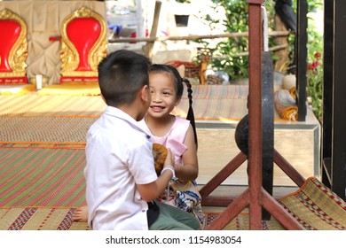 happy little asian boy and girl are playing in house area