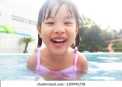 happy little asian girl in swimming pool