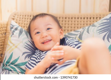 Happy Little asian toddler boy child showing front teeth with big smile and laughing: Healthy happy funny smiling face young adorable lovely male kid.Joyful portrait of asian preschool.