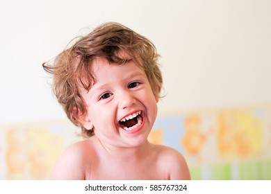 Happy little baby boy kid laughing. Smiling cute toddler.