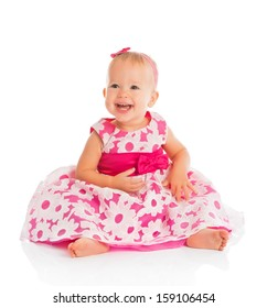 happy little baby girl in bright pink festive dress isolated on a white background