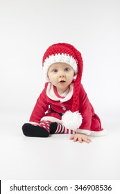 Happy little baby girl dress Santa clothes on white background.
